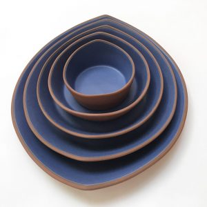 view from above of matte blue glazed nesting bowls